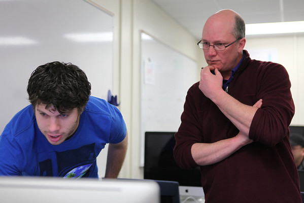 Student Jonathan Arndt and physics associate professor John Armstrong discuss some of the details of Arndt's data during Armstrong's Computational Physics course.